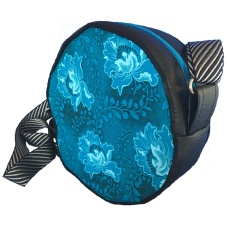 Our unique circular handbag is a stylish combination of cotton and vinyl. The perfect choice for the trendy set, it has internal pockets for a phone and other small items. Dimensions: 17 x 17 x 5cm