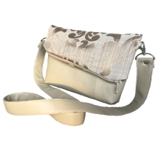 Our elegant foldover clutch with chic asymmetrical flap is made from quality vinyl and cotton. A removable strap gives you two stylish looks. Dimensions: 22 x 17 x 3.5cm